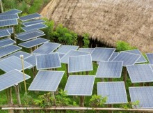 15 Dec 2013, Ubud, Gianyar Regency, Bali, Indonesia --- Solar panels in tropical garden --- Image by © Marc Romanelli/Blend Images/Corbis