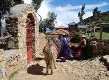 Women with mules on Isla del Sol, Bolivia.
